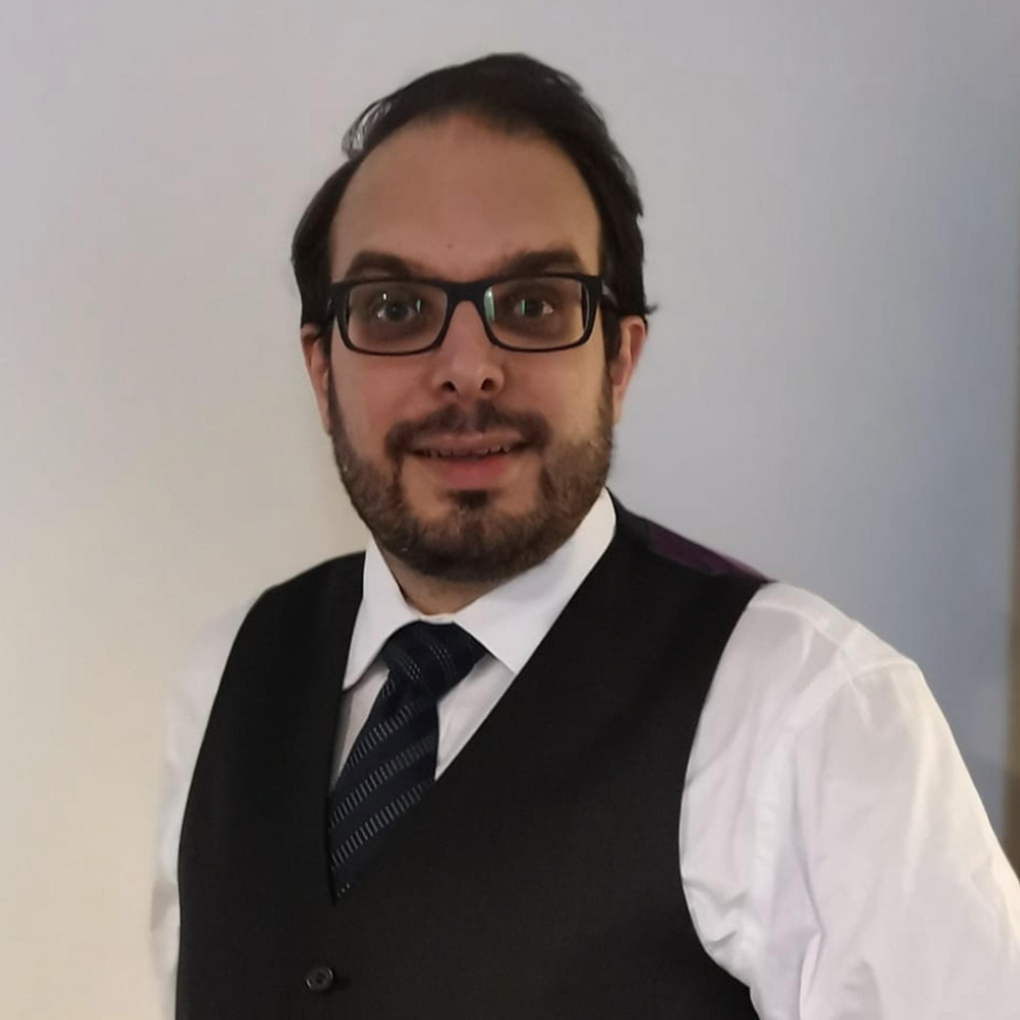 Staff profile picture of Dr Nicholas Korpelainen wearing a waist coat