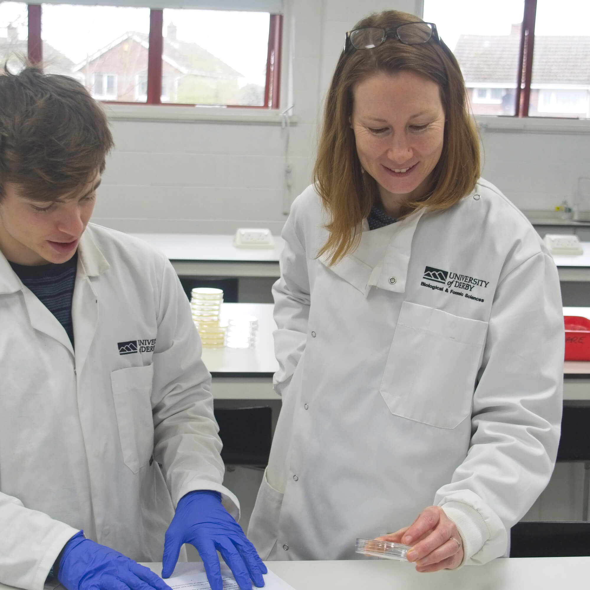 Kate teaching a student in one of the forensic labs at the University of Derby.