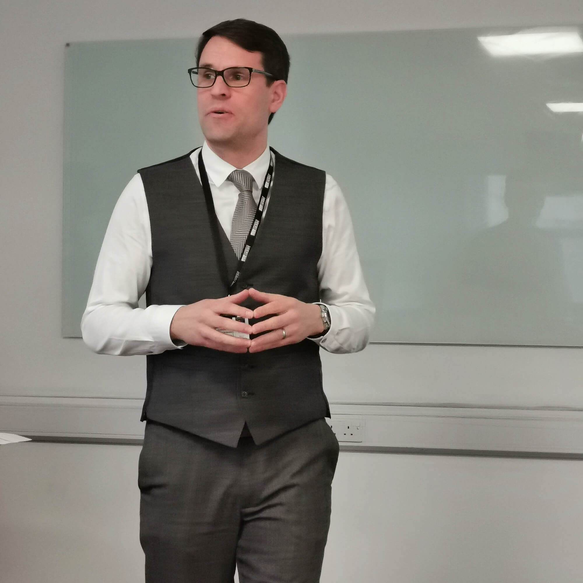 Lee Pridmore in a classroom giving a lecture.