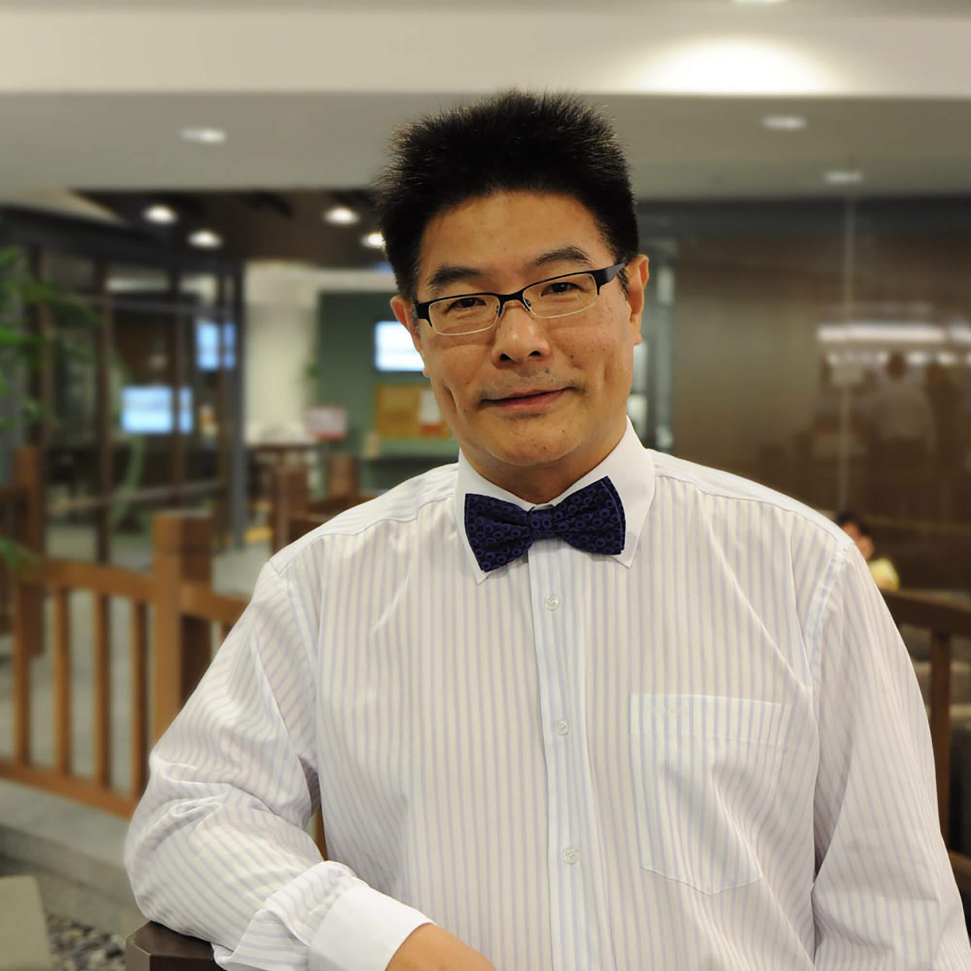 Ziguang wearing a tuxedo shirt and bow tie