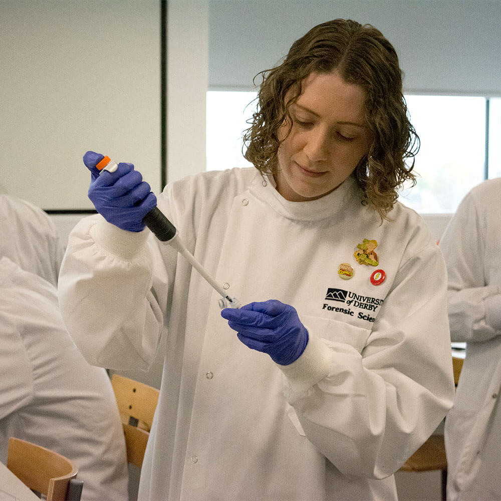 Louise Robinson in a laboratory working on Molecular Biology Forensic