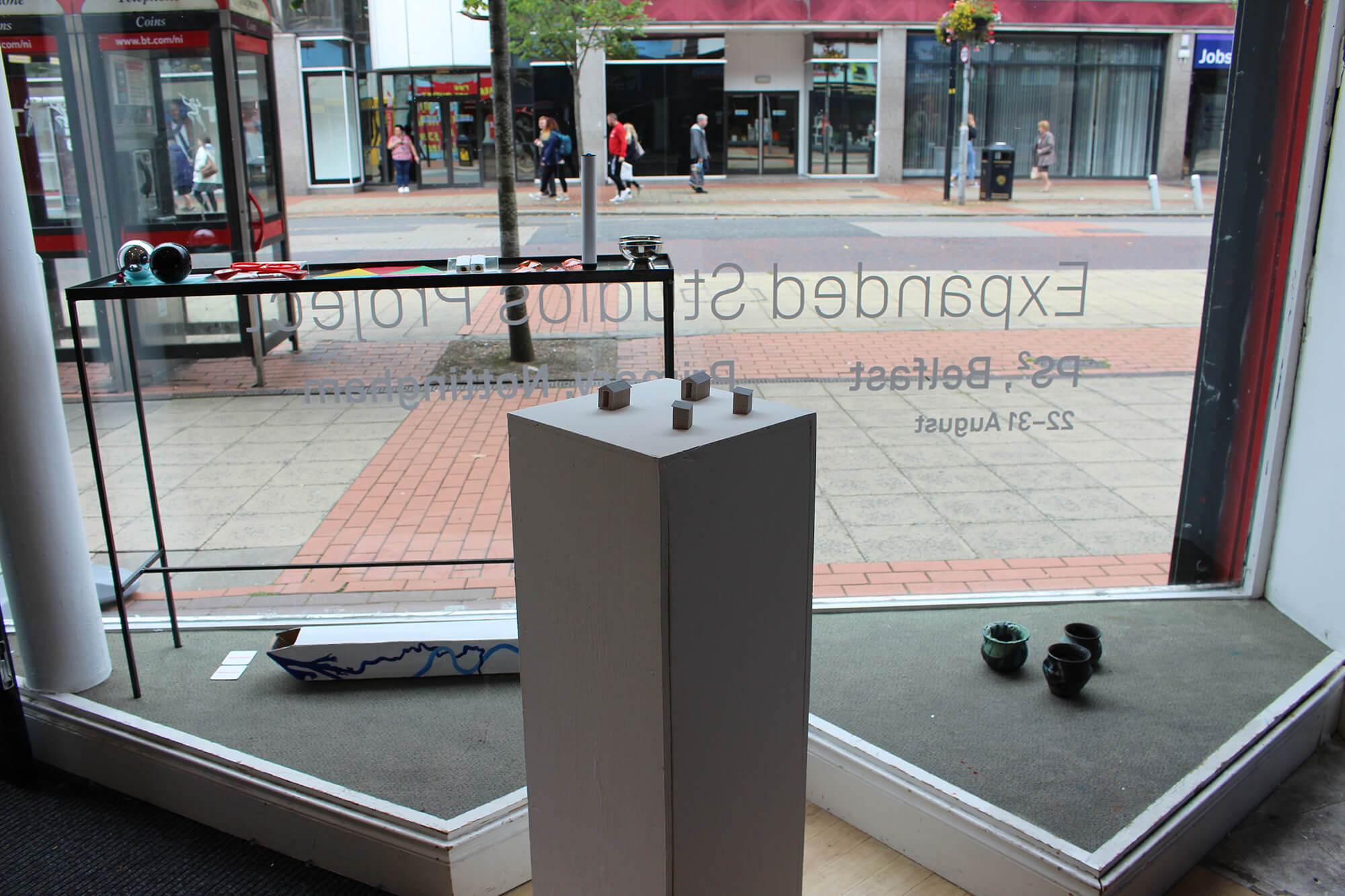 small-scale models of S.H.E.D configurations on a plinth in a gallery window