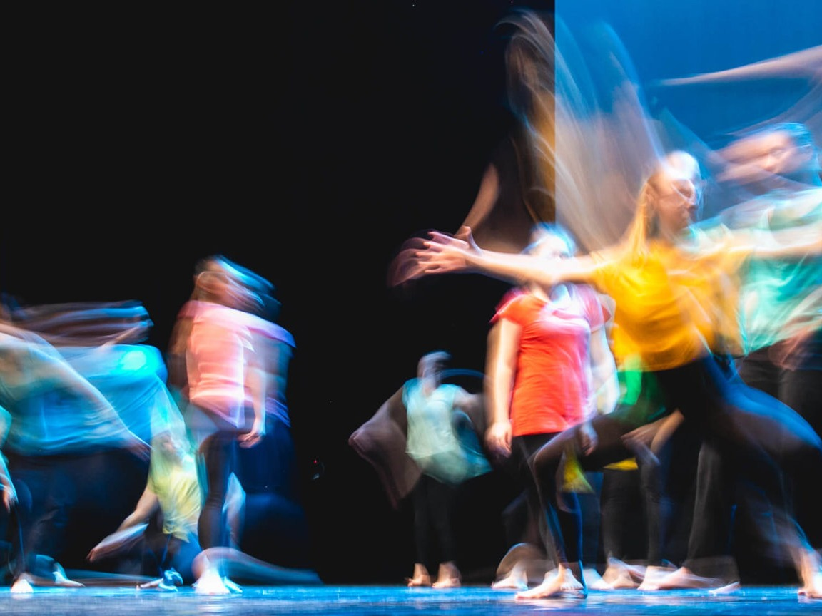 A long exposure shot of dancers on a stage