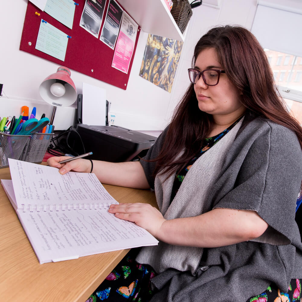 A female student reads notes